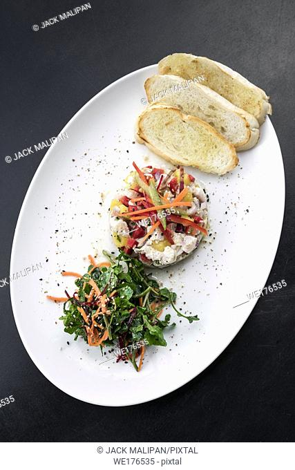 raw marinated sea bass fish ceviche salad modern gourmet fusion cuisine starter set in melbourne australia restaurant