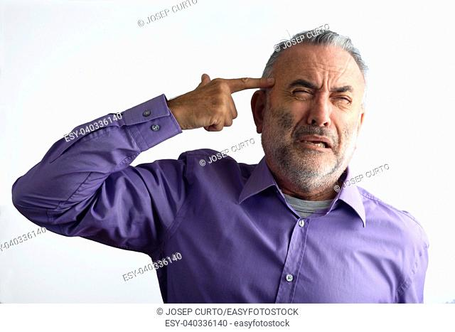 A man shooting with a finger on his head