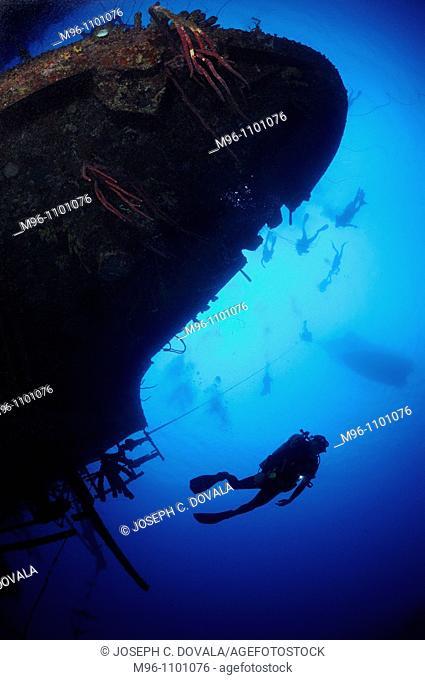 Scuba divers explore ship wreck, Hilma Hooker, Bonaire Island, Netherlands Antilles, Caribbean