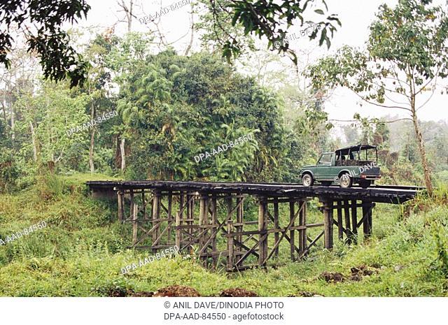 Safari Car on wooden bridge in Kaziranga National Park , Assam , India