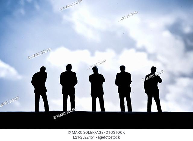Silhouettes of men watching the sky and clouds