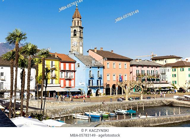 View on the waterside promenade with church and restaurants, Lago Maggiore, Ascona, Ticino, Switzerland, Alps