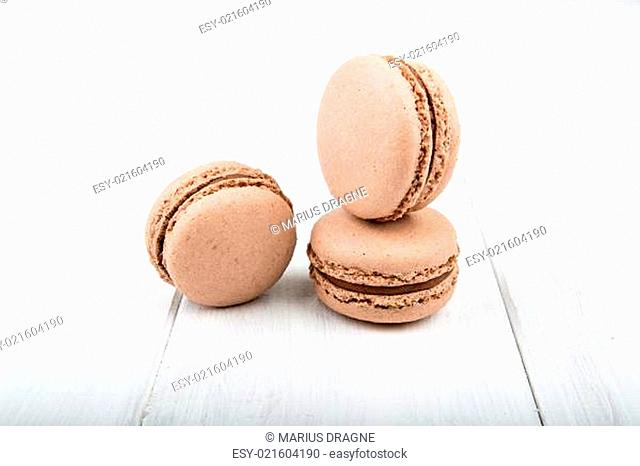 Set of macarons on white wooden table