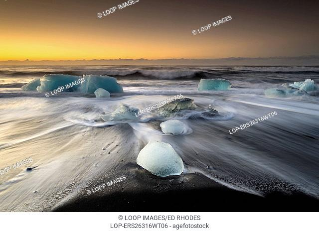 Iceburgs on the black sand beach of Jokulsa
