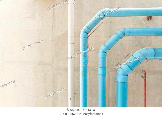 water pvc pipes hanging on cement ceiling of building
