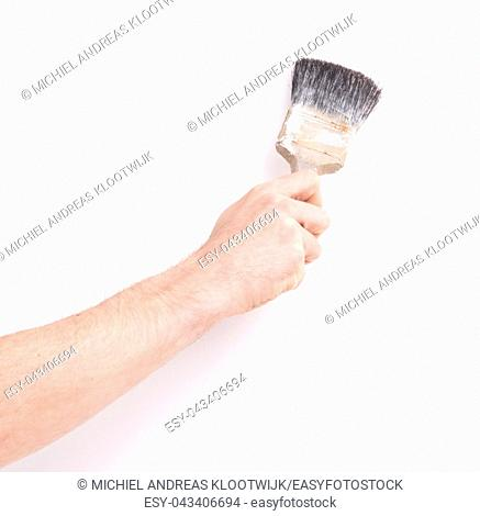 Man using old paint brush, on white background