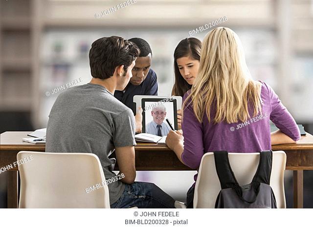 Friends studying together using digital tablet