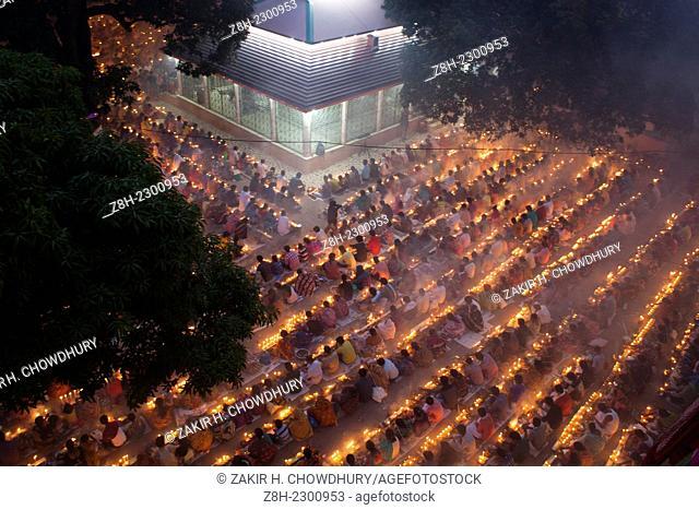 Every year thousands of Hindu devotees gather in front of Shri Shri Lokenath Brahmachari Ashram temple for the Kartik Brati or Rakher Upobash religious festival...
