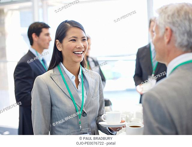 Business people talking and drinking coffee