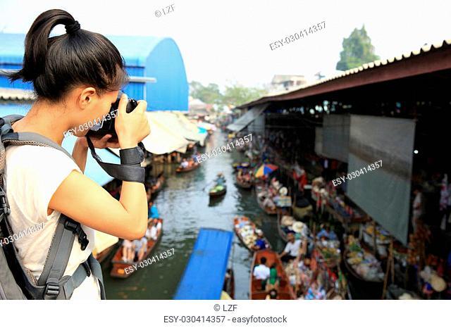 woman tourist taking photo at Damonen saduak floating market