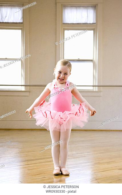 Springville, Utah, USA, Little ballet dancer 4-5 wearing pink tutu smiling, portrait