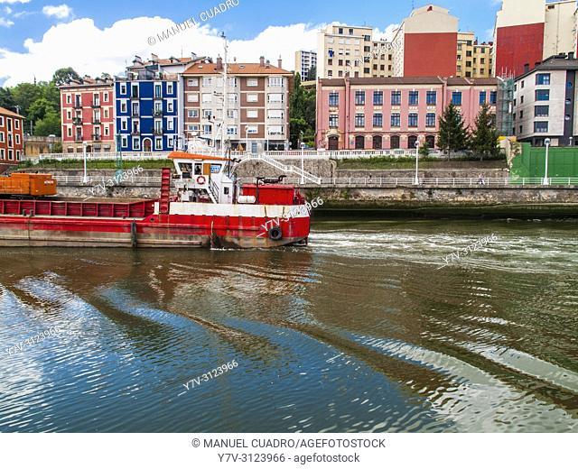 Dredger in Bilbao estuary, Olabeaga district, Bilbao, Biscay, Basque Country, Spain
