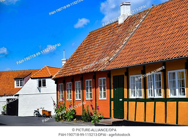 01 July 2019, Denmark, Svaneke: Typical residential buildings in Svaneke, a small town on the north-eastern edge of the Danish Baltic Sea island of Bornholm