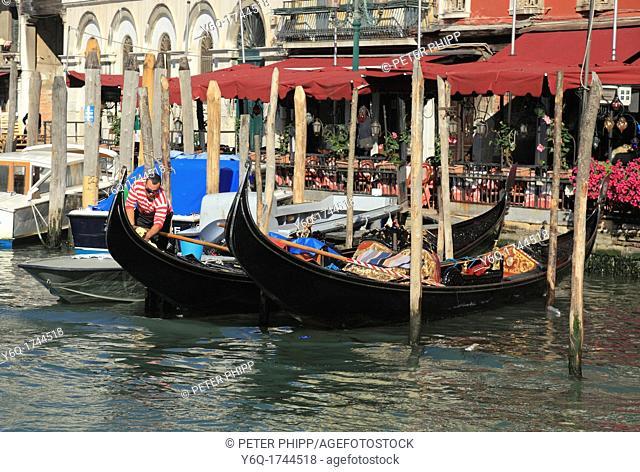Gondolier preparing gondolas for trip on Grand Canal