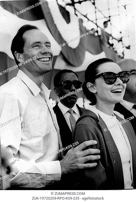 June 9, 1958 - Rome, Italy - Actress AUDREY HEPBURN and husband, actor MEL FERRER watch the Circus Maximus scene of the film, 'Ben Hur