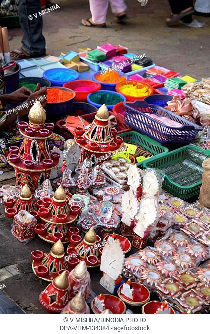 Indian Deepawali diwali festival ; sale of Decorative Items oil lamps and rangoli colors on the footpath ; Dadar Market ; Bombay Mumbai ; Maharashtra ; India