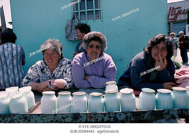 Women selling yogurt in market