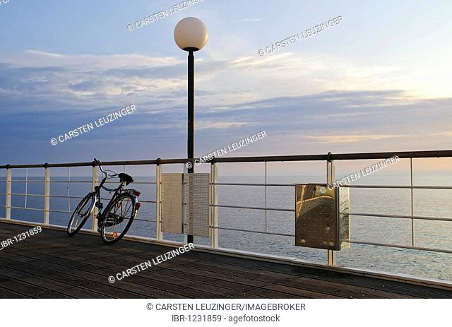 Bike leaning against railing of the pier, in the Heringsdorf seaside resort, Usedom Island, Mecklenburg-Western Pomerania, Germany, Europe