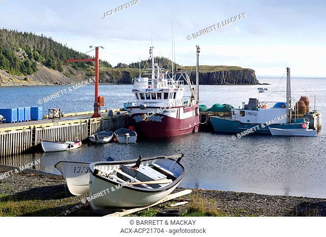 Dory arriving at trinity East wharf, Newfoundland, Canada