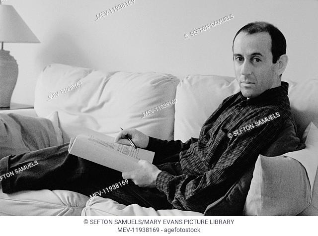 Nicholas Hytner (b.1956), film and theatre director, in his London flat