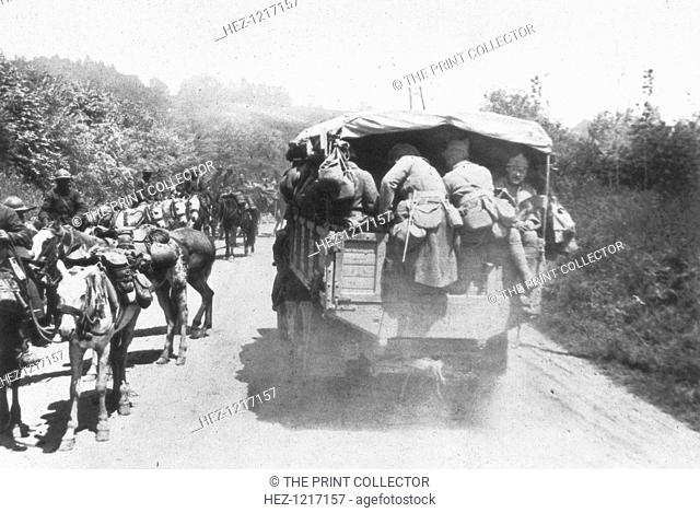 The Third Battle of the Aisne, Chemin des Dames, France, 1918. A lorry carrying French infantry passes a unit of cavalry