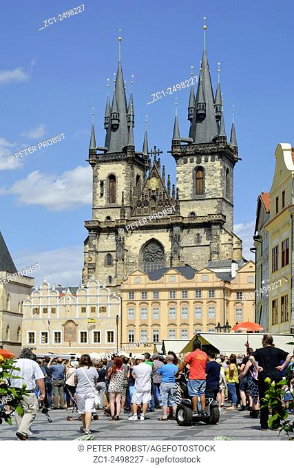 Prague, Czech Republic - July 08, 2015: Tourists at the Old Town Square in front of the Church of Our Lady before Tyn of Prague in the Czech Republic