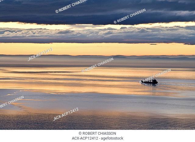 Cargo ship descending the St. Lawrence River near Les Eboulements, Charlevoix, Quebec, Canada