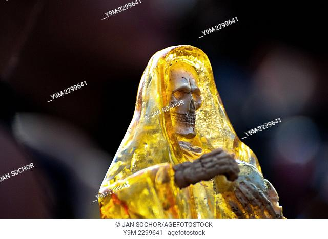 A figurine of Santa Muerte (Saint Death) seen during the pilgrimage in Tepito, a rough district of Mexico City, Mexico, 1 June 2011