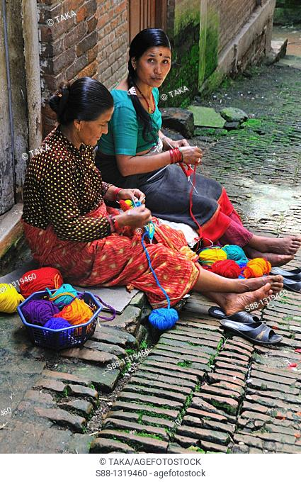 Women knitting hours everyday at the entrance of their house, Bhaktapur Bhadgaon Kathmandu valley Nepali