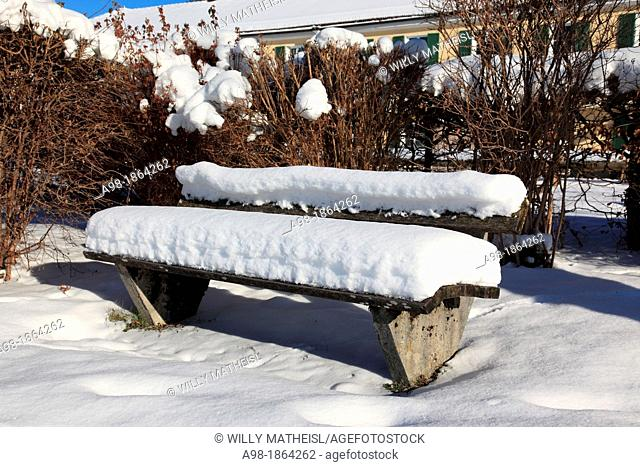 Snowy bench in Park at Lake Tegernsee, Upper Bavaria, Germany