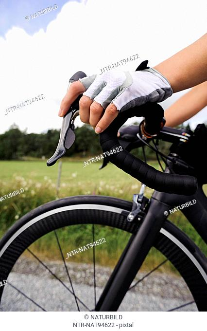 Close-up of cyclists hands
