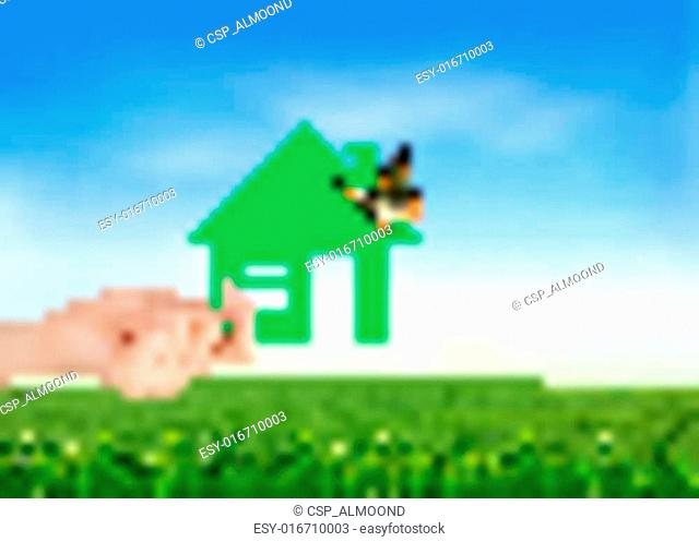 The house in hand on green natural background. Vector