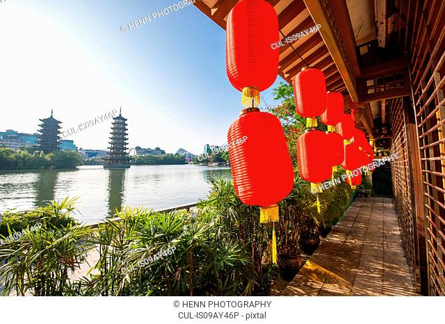 Red lanterns and the sun and moon pagodas at Shan lake in Guilin, Guangxi, China