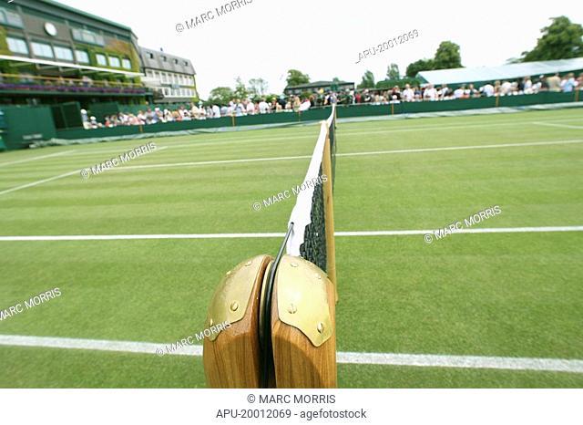 Tennis net on a grass tennis court