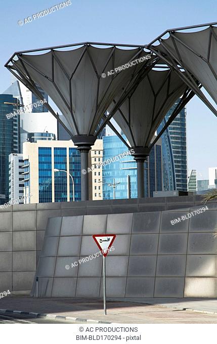 Roadsign under unique structures in Doha cityscape, Doha, Qatar