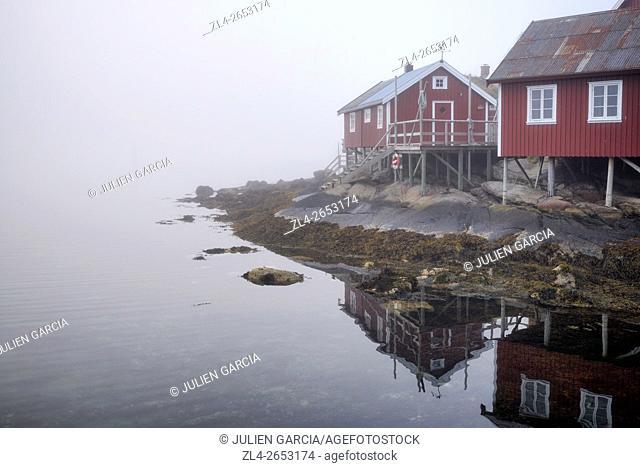 Norway, Nordland, Lofoten islands, Moskenesoy island, the fishing village of Reine, traditional fishermen cabins built on stilts (rorbu, rorbuer) in the fog