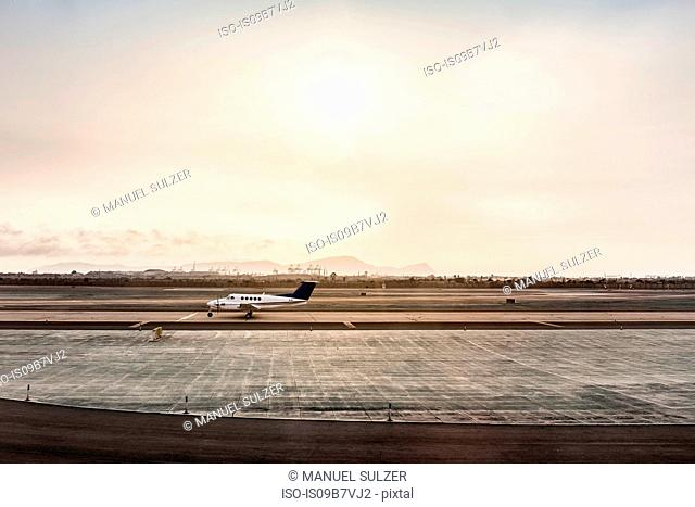 Stationary light aircraft on runway, Lima, Peru