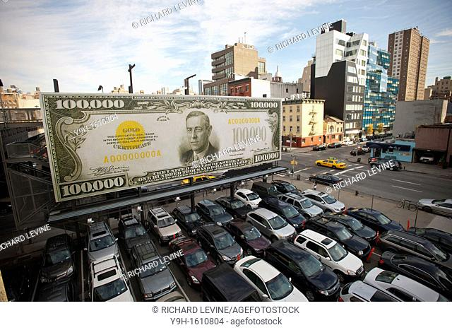 A billboard along the High Line Park in Chelsea in New York displaying 'The First $100, 000 I Ever Made' by the artist John Baldessari The artwork consists of...