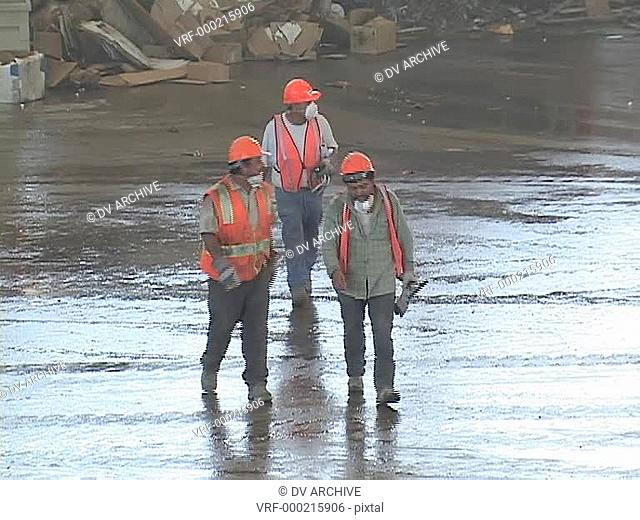 Workers exit a recycling center