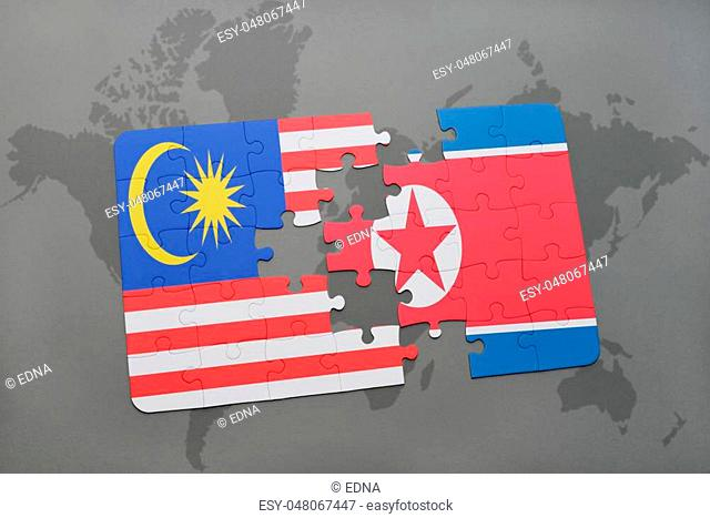 puzzle with the national flag of malaysia and north korea on a world map background. 3D illustration