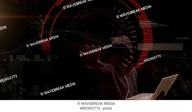 Digital composite image of hacker holding laptop while touching screen
