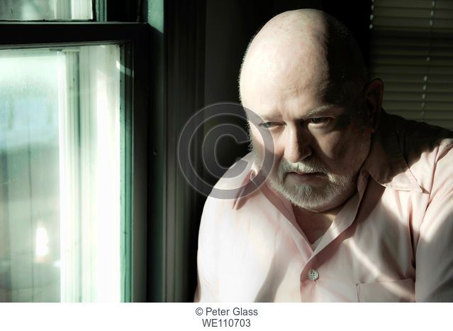 Older man by a window