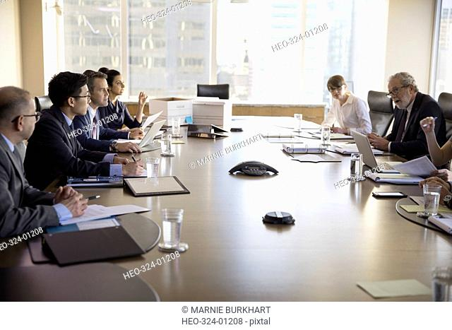 Lawyers talking in conference room meeting
