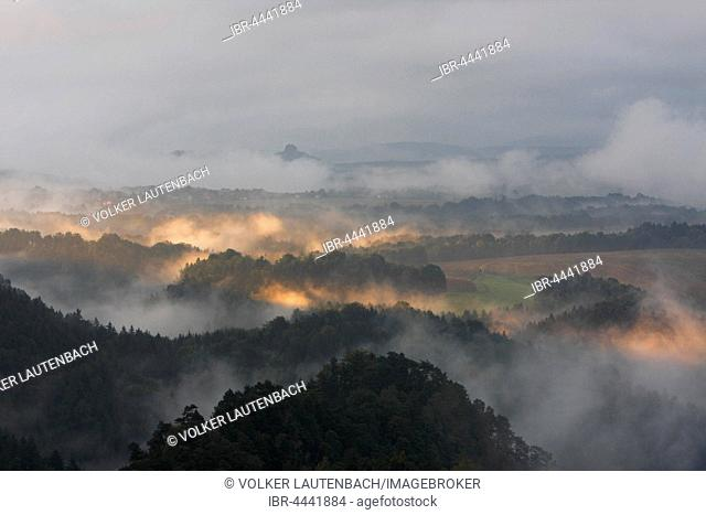 Interesting light, fog and cloud over Saxon Switzerland National Park, Saxony, Germany