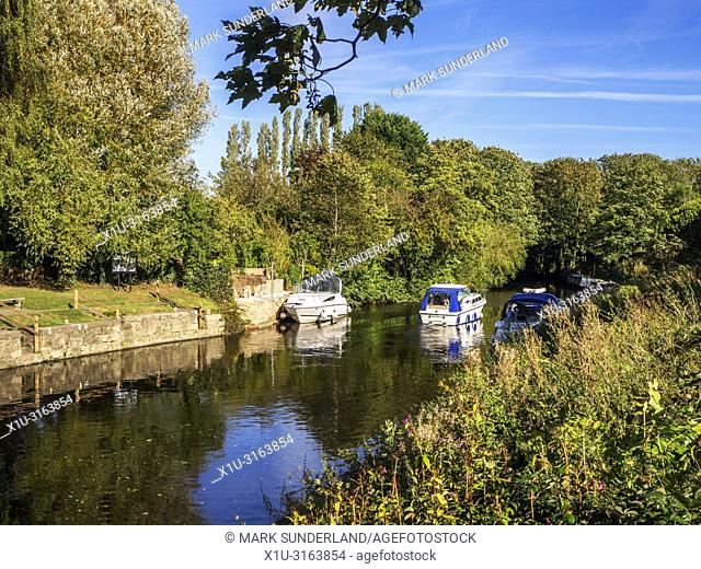Boats on the River Ure Navigation in early autumn at Boroughbridge North Yorkshire England