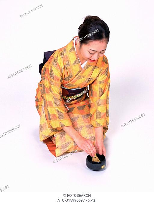 A woman in kimono making Japanese tea, High Angle View