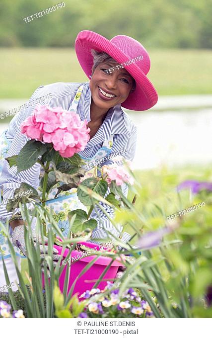 Portrait of senior woman working in garden