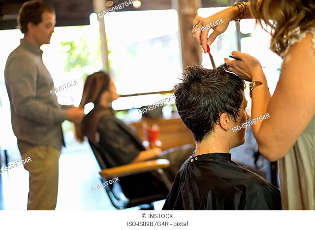 Hairstylists working in salon
