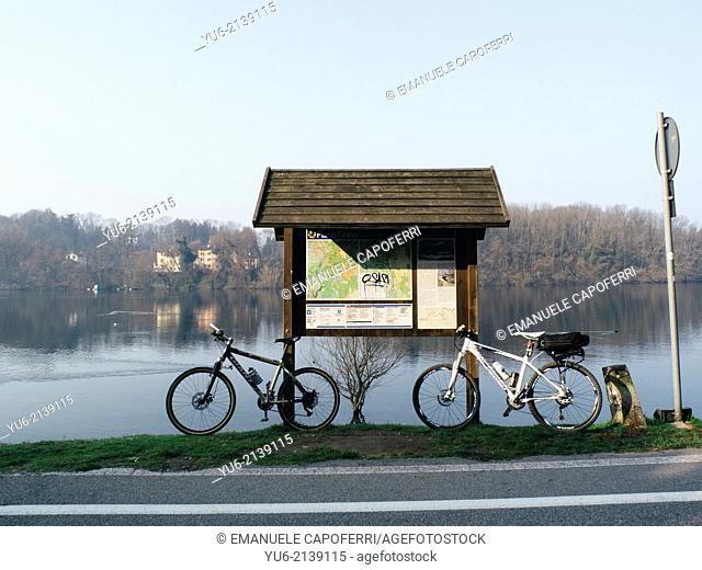 Bicycles parked on the river Ticino, Lombardy, Italy
