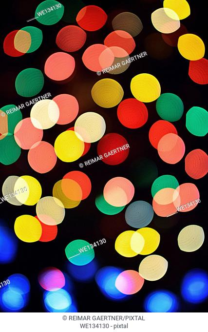 Colorful out of focus Christmas lights at night